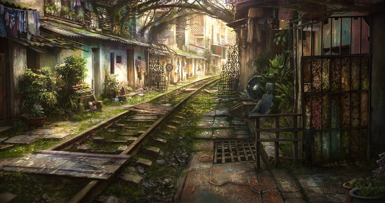 A weathered railroad track through a quiet village